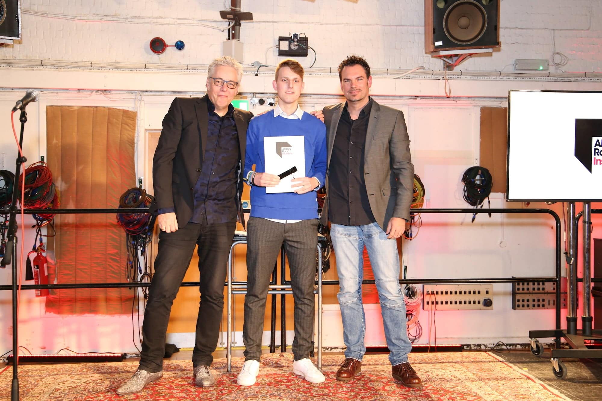 student receiving his diploma at abbey road studios